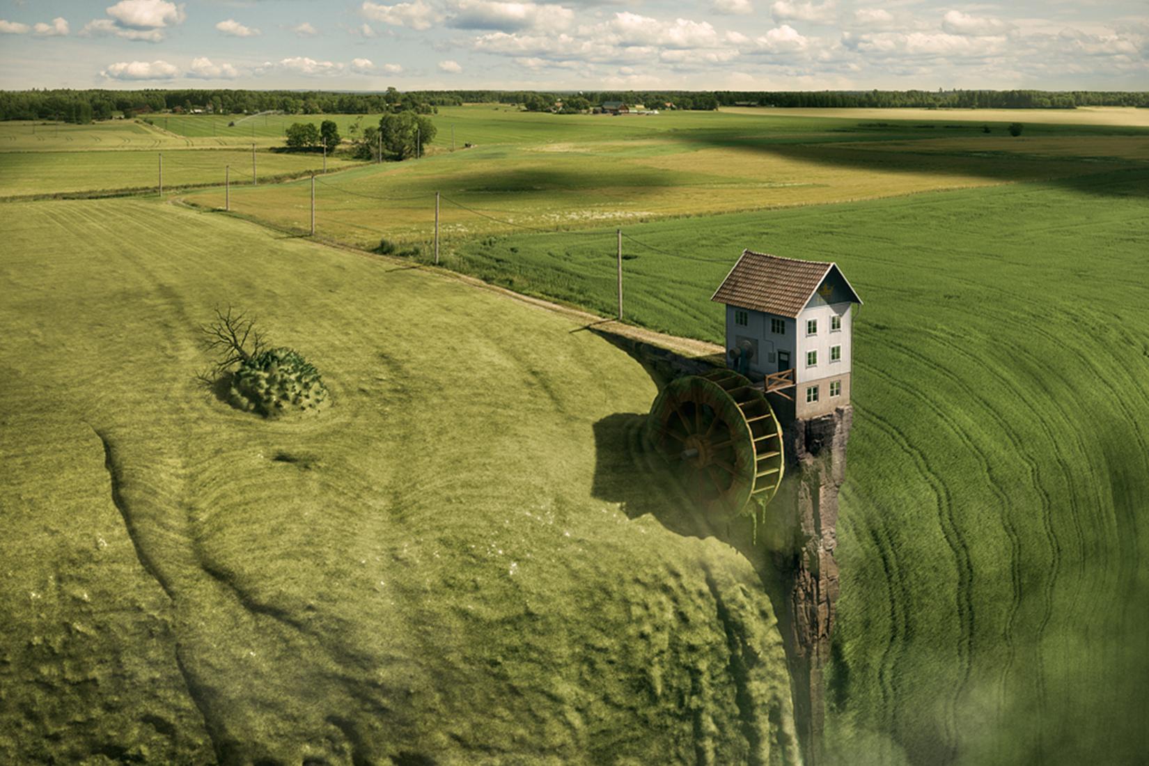 image vue du ciel d'une maison dans une prairie, mais la prairie commence à couler comme une cascade vers le vide
