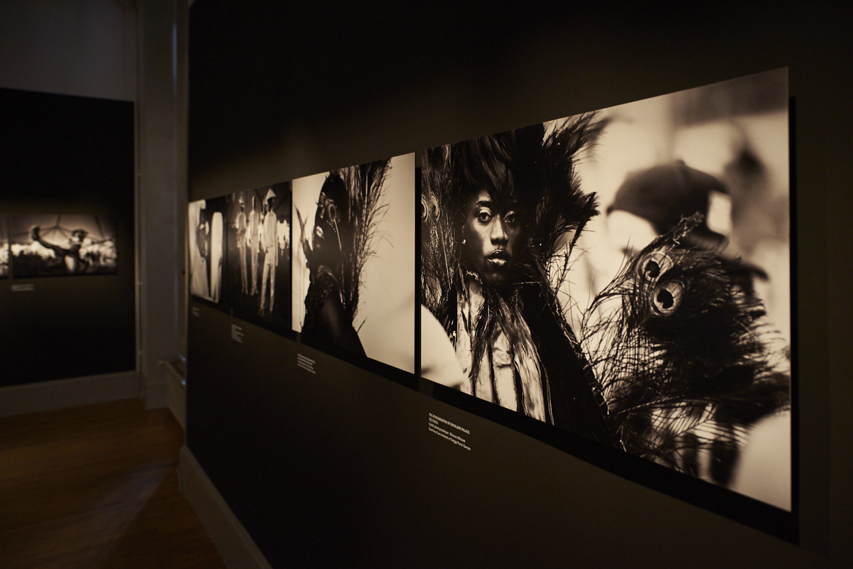 Wall with black and white photos of the exhibition
