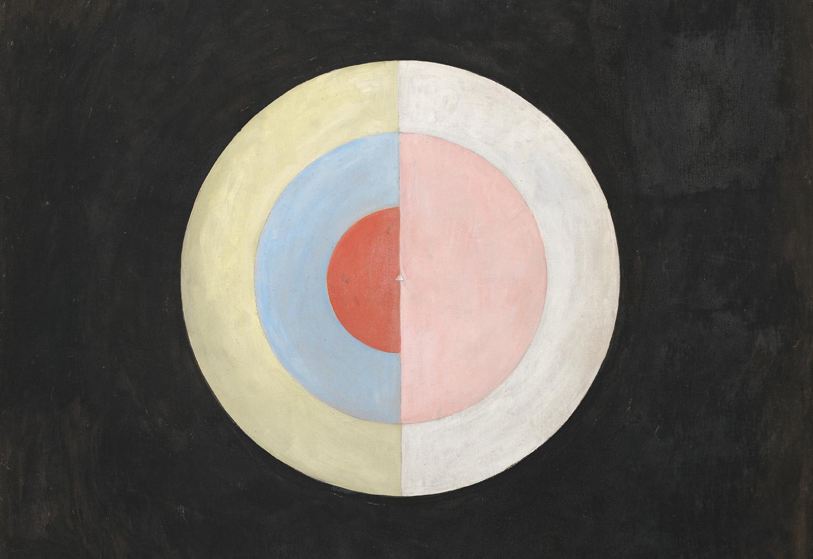 Un tableau représentant un cercle en morceaux sur un fond noir