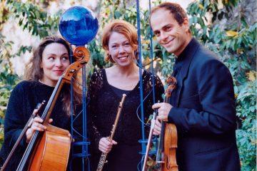 Three musicians in the garden of the Institut Suédois