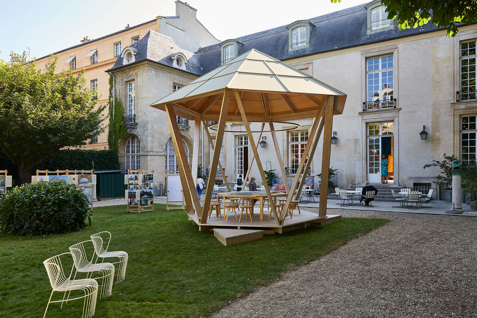 The Hexagonal Pavilion standing in the garden of the Institut suédois, with Hôtel de Marle in the background